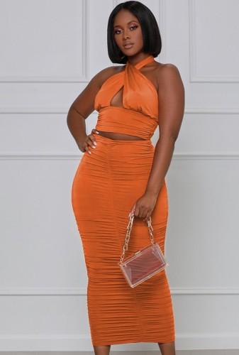 Top court à licou sexy orange d'été et ensemble de jupe mi-longue froncée assortie