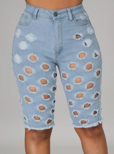 Short en jean bleu clair taille haute évidé d'été
