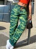 Pantalones ajustados verdes con estampado de verano