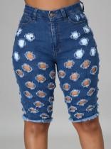 Pantalones cortos de mezclilla azul de cintura alta ahuecados de verano
