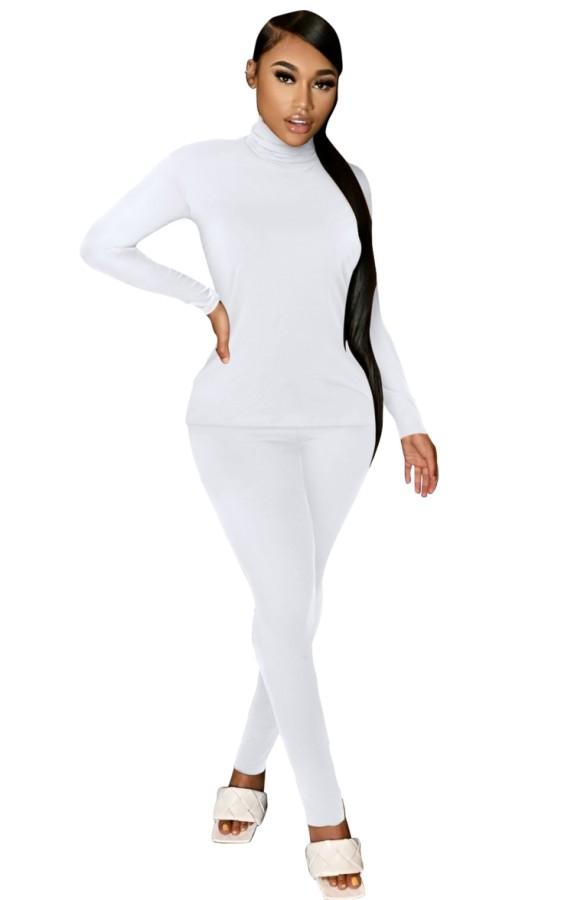 Conjunto de pantalón y camisa blanca informal de cuello alto de otoño a juego