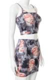 Conjunto de chaleco de tirantes con estampado de verano y minifalda a juego
