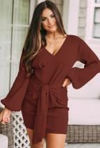 Mini abito a portafoglio annodato con maniche a sbuffo in maglia rossa autunnale