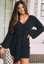 Mini abito a portafoglio annodato con maniche a sbuffo in maglia blu scuro autunno