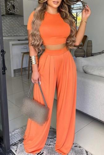 Conjunto de pantalones sueltos de cintura alta y top corto naranja formal de verano
