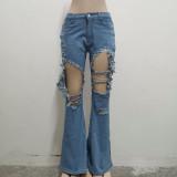 Jeans de cintura alta dañados en azul lavado de verano