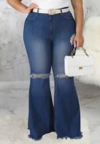 Herfst grote maat gescheurde flare-jeans met hoge taille