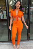 Sommer Sexy Orange geknotetes Crop Top und gestapelte Hose Set