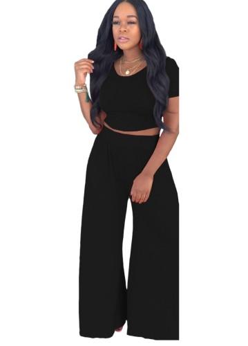 Completo estivo casual nero con top corto e pantaloni larghi