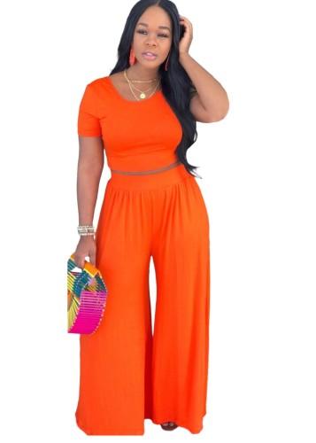 Completo estivo casual arancione con top corto e pantaloni larghi