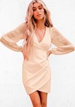 Otoño elegante vestido de fiesta cruzado beige con mangas de malla