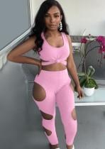 Completo rosa estivo con top corto e pantaloni tagliati sexy