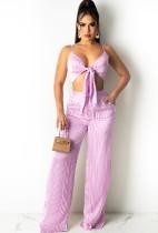 Completo estivo a righe rosa con top corto e pantaloni a vita alta