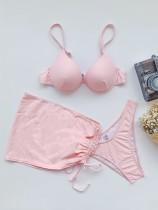 Traje de baño rosa de tres piezas con tirantes y tirantes push up