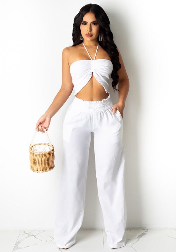Completo estivo bianco con top corto e pantaloni a vita alta