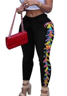 Jean skinny noir à lacets sur les côtés de couleur arc-en-ciel d'automne