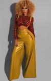 Pantaloni a gamba larga a vita alta in pelle gialla autunnale con cintura