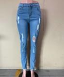 Jeans aderenti strappati blu autunnali strappati