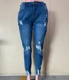 Jeans aderenti a vita alta strappati blu autunnali
