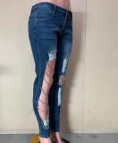 Jeans aderenti a vita alta con catene tagliate autunnali