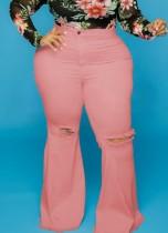 Jeans a zampa a vita alta strappati rosa taglie forti autunno