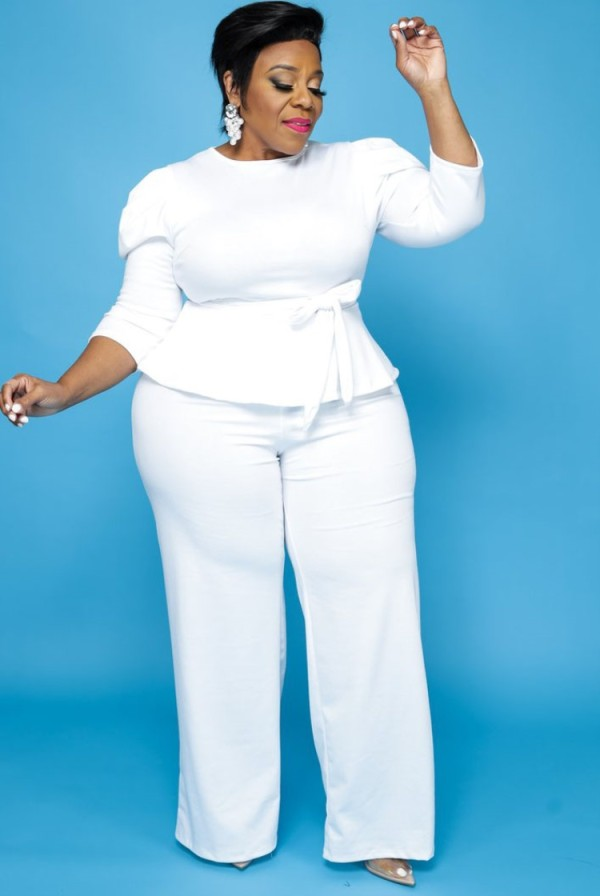 Set di pantaloni e top con peplo bianco formale taglie forti autunnali