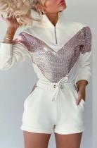 Conjunto de blusa y pantalones cortos de manga larga con cremallera de retazos de lentejuelas de moda de otoño