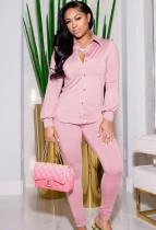 Conjunto de blusa de manga larga y pantalón pitillo con botones en color rosa otoño
