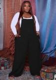 Herbst Plus Size Schwarzer Jumpsuit mit lockerem Hosenträger