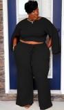 Herbst-Set aus schwarz geschlitztem Langarm-Oberteil und Hose in Übergröße