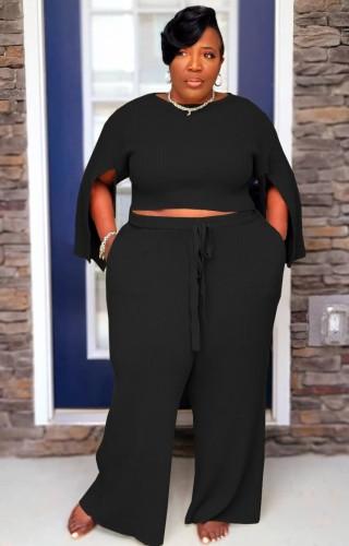 秋のプラスサイズの黒のスリット長袖トップとパンツセット