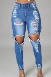 Dunkelblaue, zerrissene, schmale Jeans mit hoher Taille im Herbst