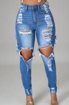 Jeans slim a vita alta strappati blu scuro autunno esposti al ginocchio
