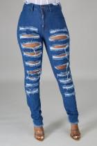 Dunkelblaue, zerrissene, ausgehöhlte High Waist Jeans im Herbst