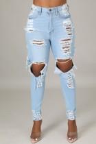 Jeans slim a vita alta a vita alta con strappi azzurri autunnali