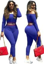 Set di pantaloni slim e top corto a maniche lunghe con spalle scoperte blu autunno