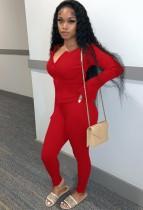 Set di pantaloni e top corto in maglia aderente rosso autunnale con cerniera