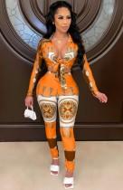 Conjunto de pantalón y blusa retro naranja con estampado de otoño