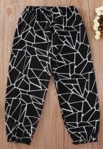 Pantaloni casual neri con stampa autunnale per bambina