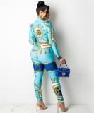 Set aus blauer Retro-Bluse und Hose mit Herbst-Print