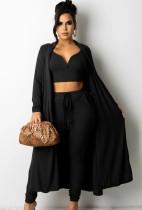 Set di 3 pezzi con top corto e pantaloni in maglia nera autunnale con cardigan abbinati