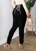 Herbst-reizvolle schwarze Rückseitenverband-angepasste Jeans