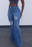 Jeans acampanados de cintura alta rasgados de otoño