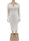 Vestido largo de manga larga con cuello redondo y botón blanco informal de talla grande de otoño