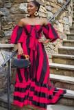 Vestido largo con hombros descubiertos y estampado de rayas rosas