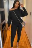 Conjunto de pantalón y camisa de manga abullonada negra casual de otoño