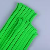 Traje de pantalón y top de punto verde elegante de invierno