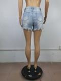 Pantalones cortos de mezclilla con flecos ahuecados y cintura alta azul de verano