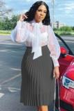 Falda plisada de cintura alta negra elegante de otoño