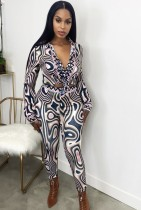 Tweedelige set retro-elegante blouse en broek met herfstprint